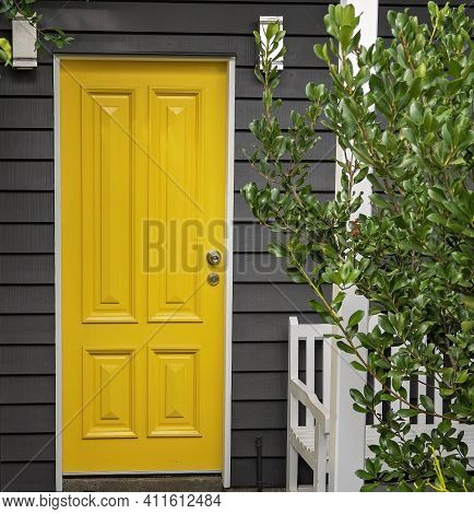 A Bright Yellow Front Entrance Door In A Renovated Old Queensland Home