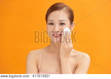 Woman Using Cotton Pad. Happy Smiling Beautiful Young Woman Cleaning Skin By Cotton Pad.