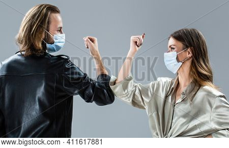 Coronavirus Epidemic. Friends In Safety Mask. Young Couple Wear Face Masks. Girl And Guy Greeting Wi