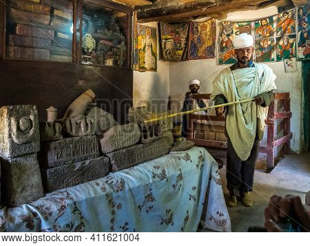 Yeha, Ethiopia - Feb 10, 2020: An Orthodox Priest Shows The Interior Of The Great Temple Of The Moon