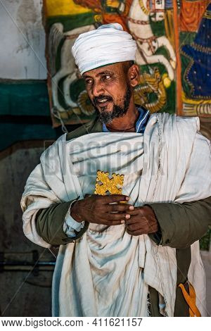 Yeha, Ethiopia - Feb 10, 2020: An Orthodox Priest The Great Temple Of The Moon, Privy To Walia Ibex