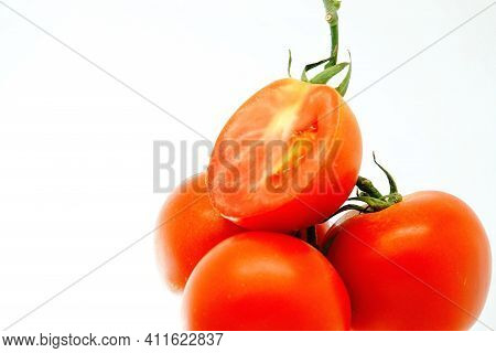 On Whit Pile Of Fresh Ripe Organic Tomato In Burlap Sack On Rotating Plate Isolatede Background
