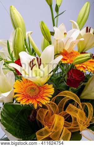 A Beautiful Bouquet Of White Lilies And Orange Gerberas