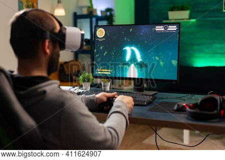 Caucasian Gamer Playing Space Shooter Championship While Wearing Virtual Reality Headset. Defeated G