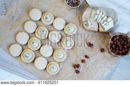 The Process Of Cooking Macaroon On A Light Background . Dorblu Cheese Filling