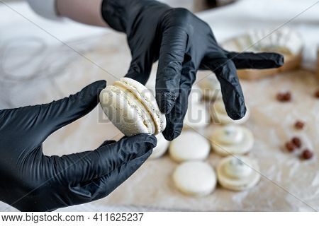The Process Of Cooking Macaroon On A Light Background Clouse Up. Dorblu Cheese Filling