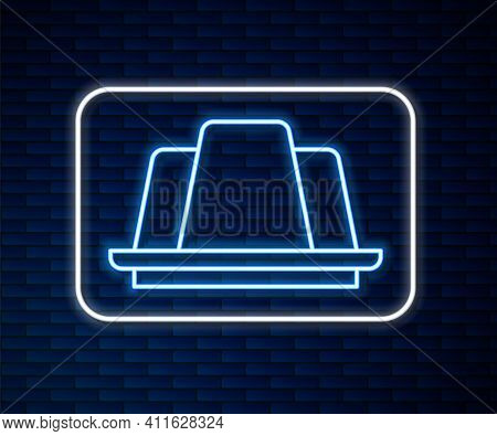 Glowing Neon Line Jelly Cake Icon Isolated On Brick Wall Background. Jelly Pudding. Vector