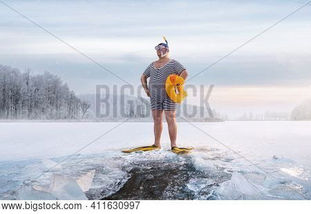Fuunny Overweight, Retro Swimmer Standing By The Ice Hole In The Lake, At The Cold Sunrise With Copy