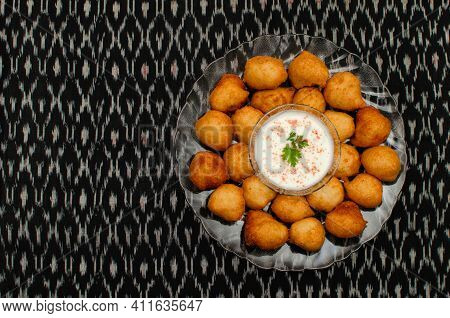Dahi Wada, Famous Indian Street Food Or Snacks In Transparent Colored Plate On Black Background