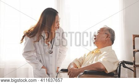 Female Nurse Doctor In Uniform Health Check Discussion Senior Grandfather Patient At Home Medical Vi