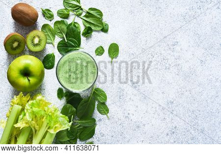 Smoothie With Spinach, Avocado And Celery Leaves On A Concrete Background. View From Above. Detox Dr