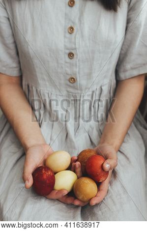 Happy Easter! Woman In Rustic Linen Dress Holding Natural Dyed Easter Eggs In Hands. Natural Painted