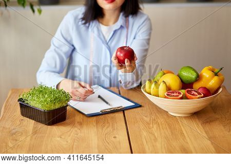 Nutritionist, Dietitian Woman At The Office, Hold Apple In The Hand