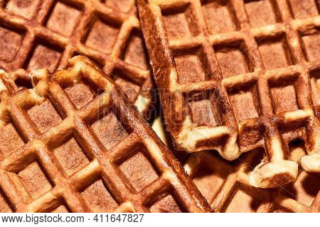 Simply Delicious. Close Up Shot Of Freshly Baked Belgian Waffles, Traditional Belgian Dessert. Unhea