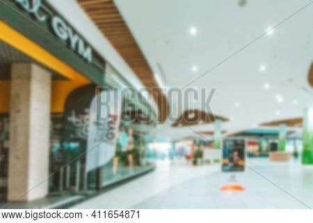 Shopping Center Building Blurred Background. People Shopping In Modern Commercial Mall Center. Inter