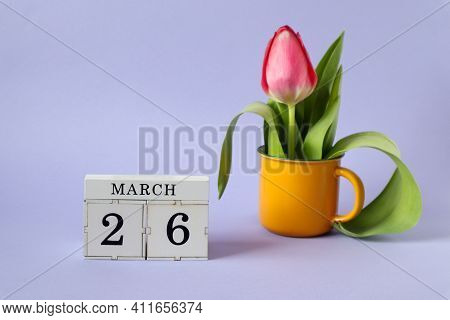 Calendar For March 26 : A Cube With The Number 26, The Name Of The Month March In English, A Scarlet