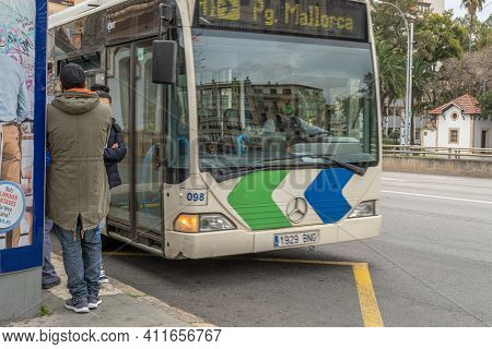 Palma De Mallorca, Spain; March 04 2021: Emt Bus Picking Up Passengers At A Bus Stop In Plaza España