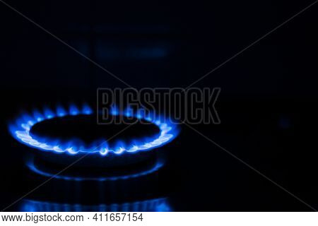 Gas Flame, Burning Gas Stove Burner On A Black Background. Copy Space.