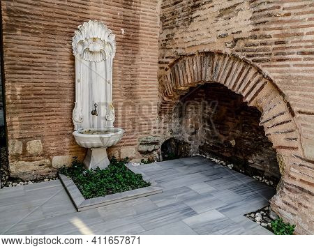 Antique Sculpted Marble Drinking Fountain In The Wall On Soguk Cesme Sk Street In Istanbul, Turkey.