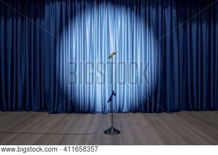 Speaker Performance Concept With Round Spotlight On Blue Curtain And Microphone On Wooden Floor Of E