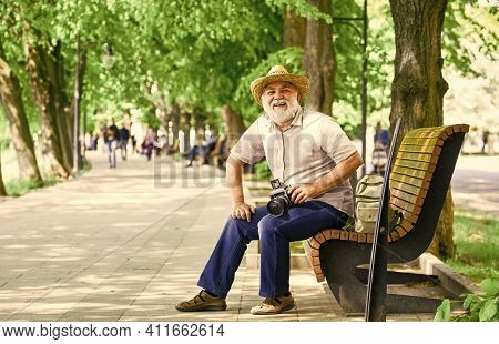 Concept Of Photography. Senior Bearded Man Photographing Outdoor. Professional Photographer Designer