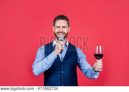 Proposing Toast. Toast Master Speak Into Microphone Lifting Glass Of Wine. Alcohol Drink Ritual. Dri