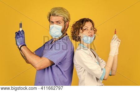 Doctor In Medical Mask Ready To Make Injection. Stop Coronavirus. Virus Infection Injection Vaccine.