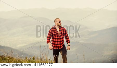 Tourist Walking Mountain Hill. Natural Power. Masculine Power. Power Of Nature. Man Stand On Top Of