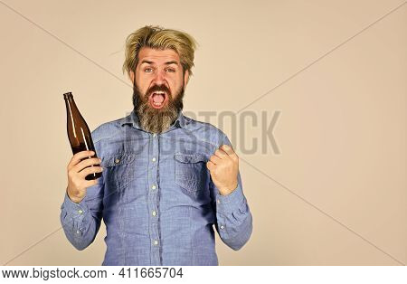 Sports Lover Cheer Up. Mature Man Holding Glass Bottle Of Beer. Drunk Hipster Male Craft Bottled Bee