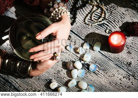 Fortunetellers Hands On A Glass Orb. Prediction Of The Future. Mystic Interior. Occult Symbols