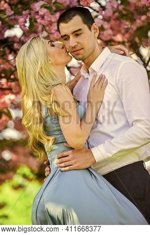 Loving People Hug. Couple In Love Under Sakura Blossom. Love Story. Couple In Love Under Sakura Blos