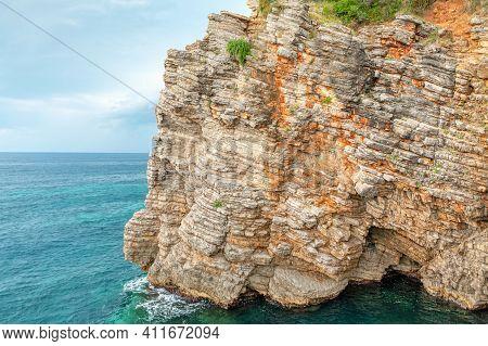 Sedimentary Coastal Rock Washed By Sea Water . Coastline Rocky Cliff