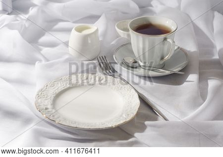Elegant Empty Plate, Cutlery, Cup Of Coffee On Sunny Morning, Clean White Tablecloth Background, Top
