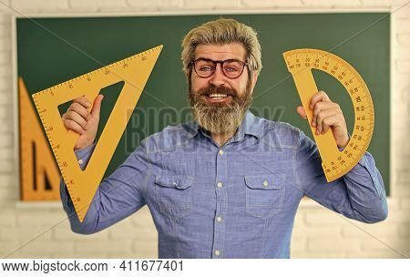 Good News. Formal Sciences. Happy Mature Teacher In Glasses. Back To School. Man Engineering Graphic