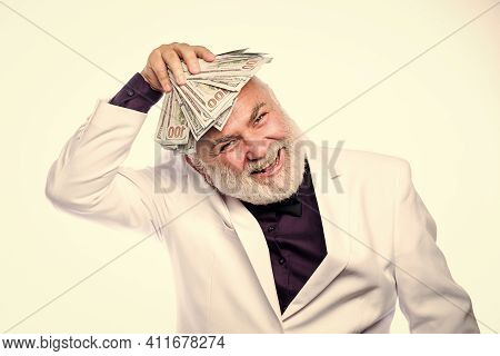 Cash Security. Rich Grandpa. Successful Lucky Businessman. Senior Man Pensioner Hold Cash Money. Ear