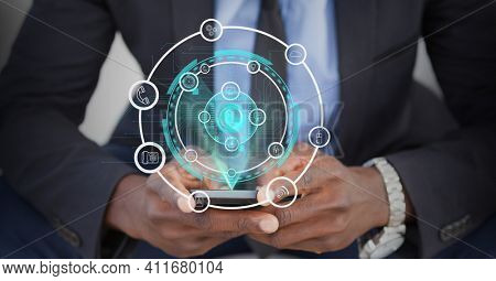 Digital interface with digital icons over mid section of business man using smartphone. global networking and business technology concept