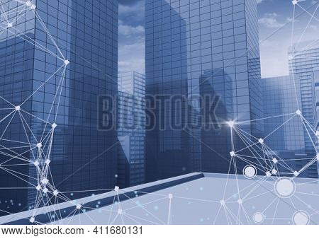 Digitally generated image of network of connections against tall buildings. global networking and business concept