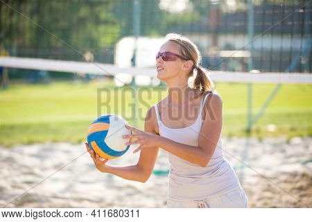 Female beach volleyball player on a sandy court