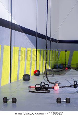 Kettlebells ropes and hammer gym with lifting bars and wall balls