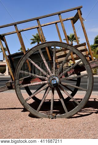 The Wooden Hub And Spokes Of The Wheel Of An Old Cart Pulled By Horses