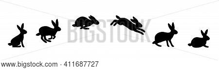 A Set Of Rabbit Jump Phases. The Hare Sits, Prepares To Jump, Jumps, Lands. Black Silhouette On A Wh