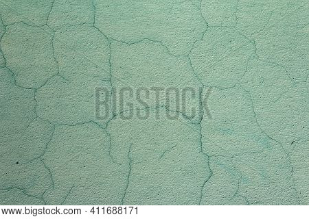 The Old Cracked Green Paint On A Wall Surface. Peeling Paint On Wall Seamless Texture. Pattern Of Ru