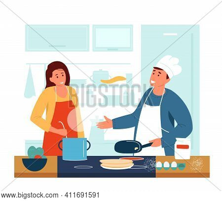 Happy Couple Cooking Together In The Kitchen. Man In Apron And Chef's Hat Making Pancakes, Woman Mak