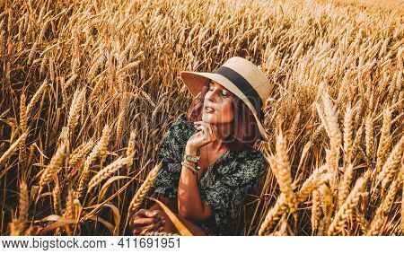 Femininity, Beauty, Travel Concept. In The Bright Light Of The Rising Sun Among The Tall Stalks Of S
