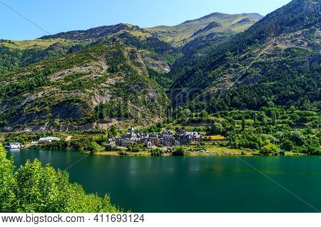 Beautiful Town On The Shore Of A Large Lake Between High Mountains In The Pyrenees, Huesca, Aragon,