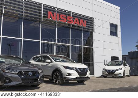 Indianapolis - Circa March 2021: Logo And Signage Of A Nissan Car And Suv Dealership. Nissan Is Part