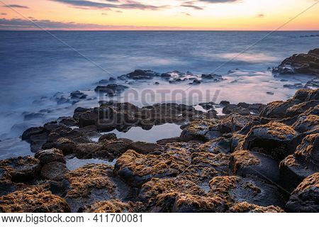 basalt rocks formation Giant's Causeway, Port Ganny Bay and Great Stookan, County Antrim, Northern Ireland, UK