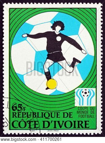 Ivory Coast - Circa 1978: A Stamp Printed In Ivory Coast Shows Player In Action, 11th World Cup Socc