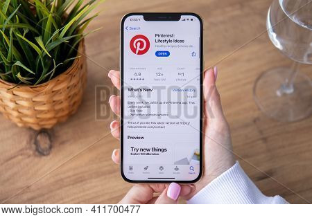 Alanya, Turkey - February 25, 2021: Woman Hand Holding Iphone 12 Pro Max Gold With App Pinterest In