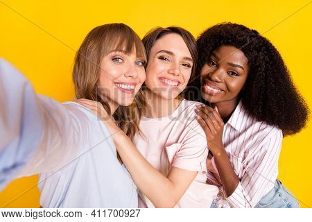 Photo Of Three Pretty Positive Girls Dark Skin Take Selfie Put Arm On Shoulder Isolated On Yellow Co